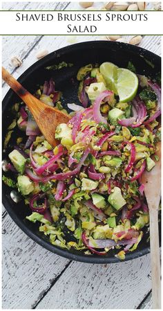 Shaved Brussels Sprouts Salad with Avocado and Pistachios - Hearty, healthy, and incredibly delicious sauteed salad packed with Shaved Brussels Sprouts, Red Onions, Avocado, Pistachios and a splash of lime juice.