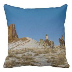 Cowboys on Ridge riding Horse through the Snow Throw Pillow