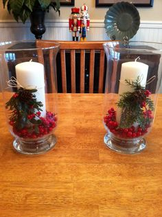 Wanted something festive for Christmas so I used the hurricane candle holders from HomeGoods, and tied artificial evergreens and berries with raffia to the candles. I couldn't find cranberry filler so I cut berries from twigs I bought at Hobby Lobby.