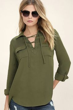 The Jack by BB Dakota Nutmeg Olive Green Lace-Up Top is all you need for a casual day lakeside! Woven rayon shapes a collared, lace-up neckline that drapes into long sleeves with button cuffs and tabs. Straight-cut woven bodice has decorative flap pockets and a high-low hem.