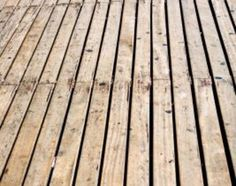 Homemade Wooden Deck Cleaner. Mix 2 gallons of water,  1/2 gallon of bleach, & 1/4 cup of liquid dish detergent - mix together until suds form. Dip a brush into the solution and brush over the entire deck. Wash with water.