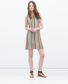 I love the colors and 70s feel of this dress.