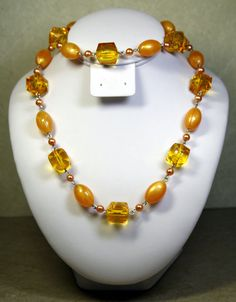 33 inch VINTAGE PLASTIC AMBER NECKLACE, CREAMY AMBER AND FACETED CRYSTAL BEADS