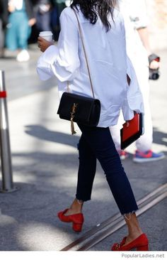 White shirt, dark jeans and red shoes