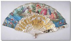 Mid 19th Century Folding Fan, with mother of pearl guards, decorated with flowers in gilt, the pierced mother of pearl sticks with a cartouche, depicting seated figures in a landscape in raised gilt enamels, within a scrolled border, the leaf with lithograph scene of figures and musicians in a landscape, flanked by painted flower sprays, musical instruments and gilt scrolls, the reverse with a lithograph of seated figures by a stream, flanked by painted mountains, gilt scrolls on pink…