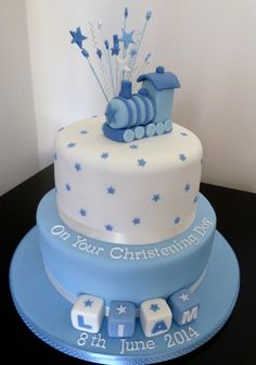 two tier boys christening cake with train