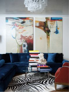 Smith Boyd Interiors via Desire to Inspire | large-scale artwork + blue velvet sofa + animal skin rug