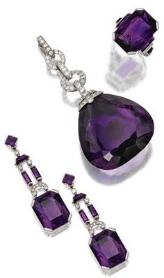 Amethyst and diamond parure, Marzo, Paris, circa 1930. Comprising a pendant, a ring and a pair of pendant-earrings, the pendant set with a large pear-shaped amethyst, the earrings and ring set with modified emerald-cut amethysts, the group further decorated with baguette, square-cut and trapeze-cut amethysts as well as with old European-cut, single-cut and rose-cut diamonds, mounted in platinum and white gold, earrings and ring signed Marzo, Paris, assay marks.