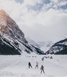 ice hockey surrounded by mountains — by @herry.with.an.e  at Lake Louise, Banff