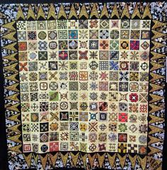 """Me Jane, You Tarzan"".  A Dear Jane quilt by Ellen at Australian Quilters Association, February 2013 exhibit. The triangle border and many of the blocks are made with animal prints. Posted by Karen Styles"
