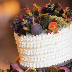 Brides.com: . The buttercream-frosted cake by Margaret's French Bakery in Campbell was decorated with a mix of seeded eucalyptus, champagne grapes, cone flowers, figs, berries, plums, rose hips and amaranthus.