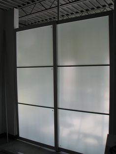 """Ikea Hack: IKEA's frosted glass and aluminium PAX STORDAL closet doors into a room divider. (Need: STORDAL doors, 4"""" L brackets, STOLMEN post, 2 metal clamps)"""