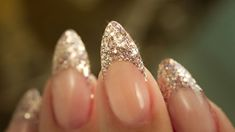 nice Almond shaped French manicure with gold glittery tip....