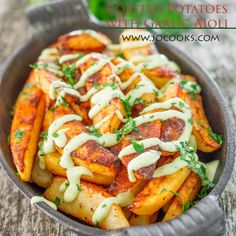 Roasted Potatoes with Garlic Aioli - learn the secret to making the perfect crispy potato wedges. These roasted potatoes are a golden perfection married together with a delicious garlic aioli.