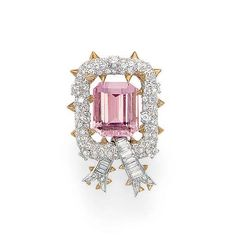 A PINK TOURMALINE AND DIAMOND BROOCH, BY JEAN SCHLUMBERGER, TIFFANY & CO.  Set with a rectangular-cut pink tourmaline, weighing approximately 18.41 carats, within a circular-cut diamond openwork bombé surround, with polished gold accents, to the baguette-cut diamond ribbon, mounted in platinum and 18k gold, in a Tiffany & Co., black suede case  Signed Tiffany & Co., Schlumberger, no. 348