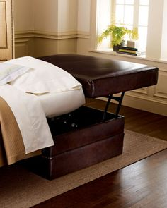 """Leather Sleeper Ottoman by Old Hickory Tannery at Horchow. Extra seating or an extra bed — whatever you need, this ottoman provides. Brown stain-resistant leather. Both styles open to 106""""L x 29""""T beds (mattresses included). Single sleeper, 34""""W x 34.5""""D x 20""""T when closed. Twin sleeper, 46""""W x 34.5""""D x 20""""T when closed."""