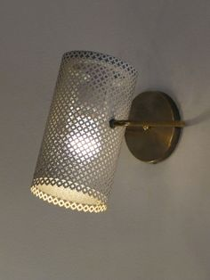 Pierre Guariche; Brass and Enameled Perforated metal Wall Light, 1950s.