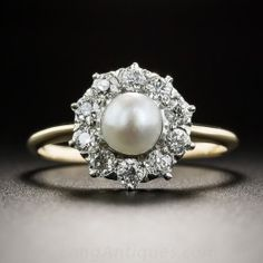 A classic turn-of-the-century halo ring, hand-fabricated in platinum over gold and featuring a natural 'oriental' pearl (5+ mm.) enveloped by a frame of sparkling white European-cut diamonds. A timeless traditional Victorian treasure. The top measures 5/16 inch. Transitional late-Victorian/Edwardian. Currently ring size 6.