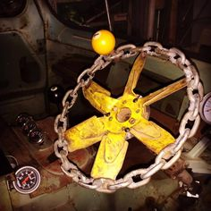 right hand drive custom steering wheel made from a chain and an old mechanical engine fan