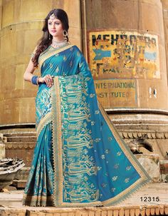 Look spectacular for the next occasion or wedding function in a blue color dual tone silk artistic work and cut work border wedding wear saree. This stylish saree will catch the attention in the middle of the crowd. Art Silk Sarees, Silk Sarees Online, Fancy Sarees, Party Wear Sarees, Indian Beauty Saree, Indian Sarees, Raw Silk Fabric, Traditional Sarees, Indian Ethnic Wear