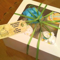 Cupcake onesies I made for a friend who is expecting. Packaged in a bakery box. click the picture for something special :)