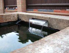 George Mudie's raised pond with railway sleepers