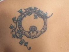 Claddagh tattoo. I like this a lot with the ivy, i'd just prefer the hear and crown to be a bit neater.