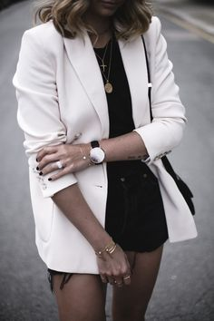 Emma Hill wears cream double breasted blazer, black vintage Levis 501 shorts, black t-shirt, layered gold necklaces, Celine box bag, chic summer outfit