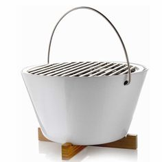 When not grilling, empty the dish-washer safe stoneware bowl and use it for serving salads, soup or as an ice bucket.