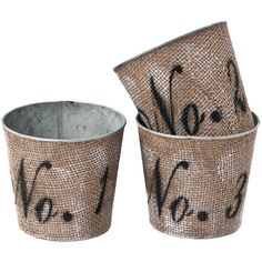 DIY :: Numbered, Burlap Planters :: Use galvanized pots or pails (terracotta pots would work, too) & cover w/ burlap using Mod Podge. Sponge white paint on here and there to distress. Then cut out stencils printed in a font u like w/ an x-acto blade. Lightly spray w/ Sulky Temporary Spray Adhesive & apply to the front of the planter. Spray paint in black. Remove stencil. Done!