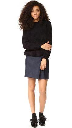 Soft yarns compose this chunky knit Maison Kitsune sweater. Ribbed crew neckline. Long raglan sleeves.
