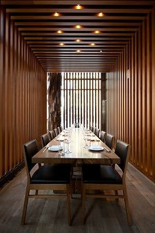 Private dining room at Chicago's Roka Akor - I have always loved the vertical wood slat look. It serves as a good partition without completely enclosing the area