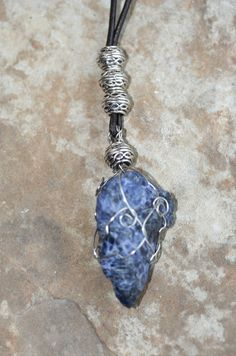 Sodalite stimulates Pineal Gland, clears Third Eye, deepens meditation, clears EMFs, combines Throat/Third Eye energies to fuse logic/intellect with intuitive knowledge, carries altruistic/idealistic energies, promotes companionship & cooperation, helps bring ingrained, unhealthy patterns to the surface for healing/releasing, & helps you to see the underlying cause to problems. Use to bring about productive dreaming.
