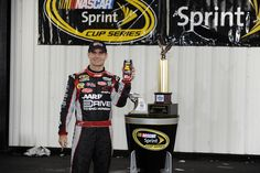 """Jeff Gordon celebrates his first win of 2012 in an """"indoor"""" Victory Lane at Pocono Raceway. The win puts Gordon at the top of the all-time Pocono wins list. His Pocono-win die-cast is available for pre-order now at the NASCAR Superstore, your local dealer or through www.lionelnascar.com."""