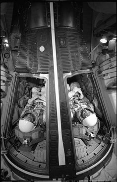 Astronauts James McDivitt and Ed White inside the Gemini spacecraft for a simulated launch at Cape Canaveral, Florida, 1965
