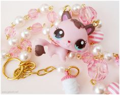 Pink Kitten Necklace, Littlest Pet Shop Repurposed Figure on Beaded Pastel Pink and White Pearl Chain in Gold. $26.00, via Etsy.