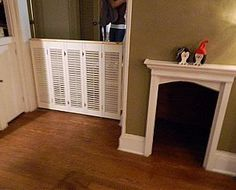 DIY Dog Gate / Dog Door: old shutters! Another good idea.