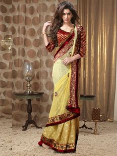 Wedding Sarees Online Shopping India | Stun all your loved ones with your new look in this yellow net saree by kalazone. The sarees beauty lies in its excellent color combination and embroidery work on the borders and motifs on the pallu. The patli has brocade work on it giving it an extra ordinary look. It is teamed with a contrasting blouse. (Slight variation in color is possible) Buy Now - http://www.kalazone.in/wxv-1496.html