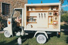 Sparkling wine, beer van and italian prosecco. Vintage ape car from 80s. Italy. Tuscan Wedding beer station.