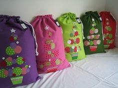 Santa Sacks- Each child leaves their sack by the tree and Santa fills them with unwrapped toys Christmas Eve. Family presents remain wrapped under the tree but this is a great way to avoid wrapping ALL the gifts. Great tradition and fun for the kids!