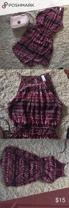 Tribal Print Halter Dress Size XL. Fits like a LARGE. Does not fit me anymore. Worn once. Faux leather rope around stretchy waistband. Hits at the knee. Lace detail back. No Boundaries Dresses Midi