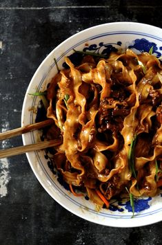 "Zha Jiang Mian (炸酱面), or ""Fried Sauce Noodles…"" So famous in China that the mere mention of it immediately makes people think of Beijing. It's sold everywhere—from street vendors to restaurants in five star hotels. Prices can vary from 10RMB (about $1.60) to 100RMB, but trust me: higher prices don't necessarily guarantee better taste. A dish …"