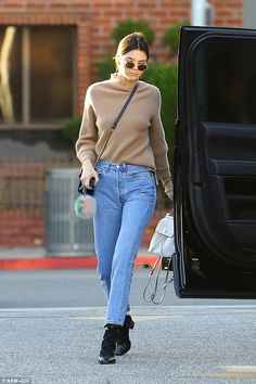 Kendall Jenner cuddles precious dog as she steps out in stylish jeans and turtleneck | Daily Mail Online