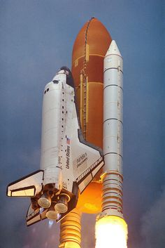 The Space Shuttle Discovery soars from Launch Pad Aug. Original from NASA. Digitally enhanced by rawpixel.