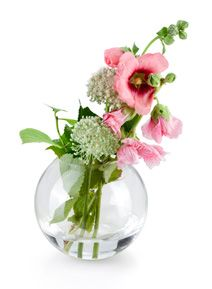 Tame a wild romance in a standout version of the bowl vase. Inspired by the passion of Gone with the Wind, take a bright pink poppy and combine with buttercup flowers and set in the bowl vase at a slight angle. Add short cut grass leaves to the centre and align accordingly. Place the completed design on a vintage dresser for a fresh splash of colour.