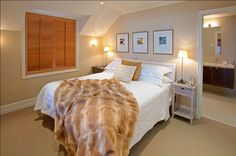 Guest Room at 5 star hotel: Eichardt's Private Hotel & Lakefront Apartments. This hotel's address is: 2 Marine Parade Queenstown City Center Queenstown and have 9 rooms Cosy Bed, Luxury Accommodation, Hotel Suites, Guest Room, Interior, Lake Front, Furniture, Pacific Ocean, Star