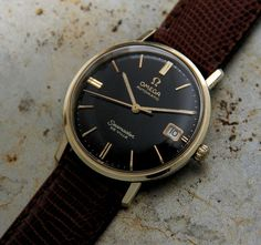 This Omega 1963 Seamaster De Ville with calendar is a beautiful piece. With the black dial enhancing the gold hands and gold baton markers, it becomes a statement of style and confidence. The case, made with a layer of real gold melted onto a base of steel, holds the original 24 jewels calibre 562 automatic movement with its 19,800 bph (5.5 beats persecond)andsweeping second hand. The movement is held safe … Read More →