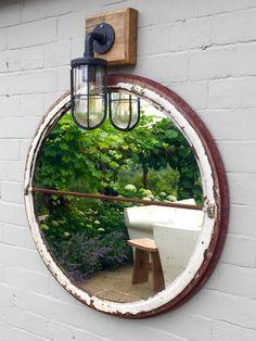 Rustic circular window mirror ..