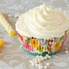 Fluffy Dairy-Free Lemon Frosting from Gluten Free Gigi makes the perfect dairy-free topping for your next batch of gluten-free, dairy-free cupcakes!