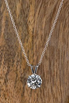 Classic style meets elegant sparkle with a timeless diamond pendant necklace from Forevermark. This classic diamond necklace is the perfect gift to give someone you love 'just because'.